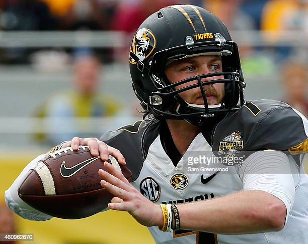 Maty Mauk of the Missouri Tigers attempts a pass during the Buffalo Wild Wings Citrus Bowl against the Minnesota Golden Gophers at the Florida Citrus...