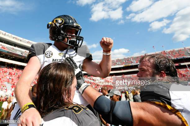 Maty Mauk of the Missouri Tigers celebrates their 4126 win over the Georgia Bulldogs with Connor McGovern and Mitch Morse at Sanford Stadium on...