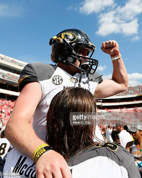Maty Mauk of the Missouri Tigers celebrates their 4126 win over the Georgia Bulldogs with Connor McGovern at Sanford Stadium on October 12 2013 in...