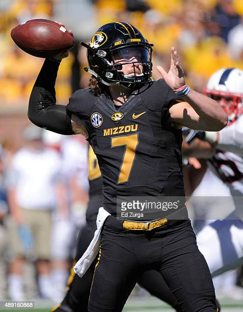 Maty Mauk of the Missouri Tigers drops back for a pass against the Connecticut Huskies in the first quarter at Memorial Stadium on September 19 2015...