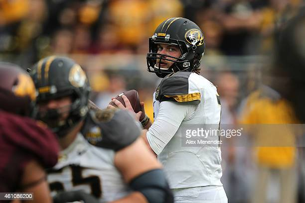 Maty Mauk of the Missouri Tigers drops back to pass during the Buffalo Wild Wings Citrus Bowl against the Minnesota Golden Gophers at the Florida...