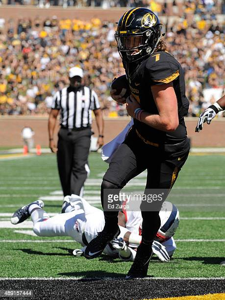 Maty Mauk of the Missouri Tigers goes in for a twoyard touchdown run against the Connecticut Huskies in the third quarter at Memorial Stadium on...