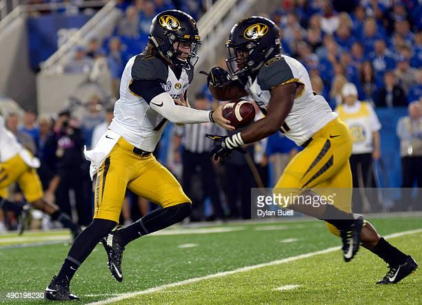 Maty Mauk of the Missouri Tigers hands off to Ish Witter of the Missouri Tigers against the Kentucky Wildcats at Commonwealth Stadium on September 26...