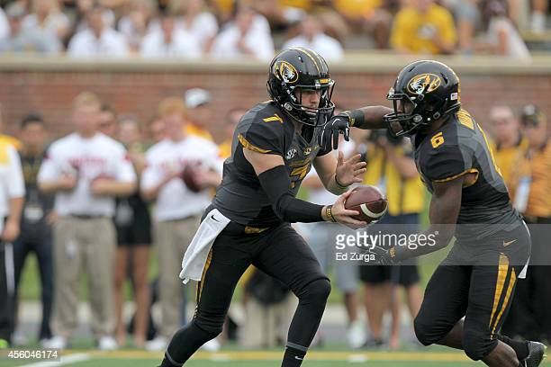 Maty Mauk of the Missouri Tigers hands the ball off to running back Marcus Murphy during a game against the Indiana Hoosiers at Memorial Stadium on...