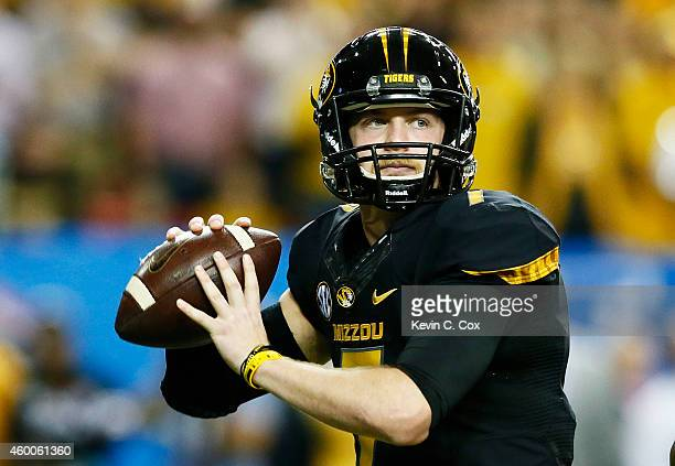 Maty Mauk of the Missouri Tigers looks to pass against the Alabama Crimson Tide in the first quarter of the SEC Championship game at the Georgia Dome...