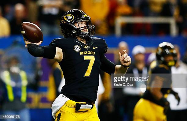Maty Mauk of the Missouri Tigers looks to pass against the Alabama Crimson Tide during the SEC Championship game at the Georgia Dome on December 6...