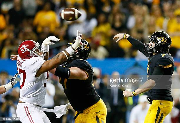Maty Mauk of the Missouri Tigers passes against the Alabama Crimson Tide during the SEC Championship game at the Georgia Dome on December 6 2014 in...
