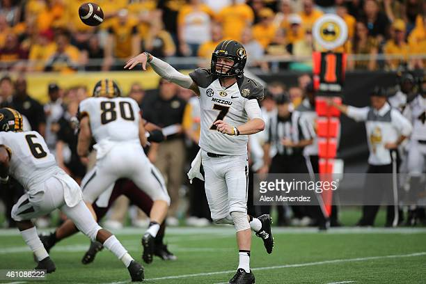 Maty Mauk of the Missouri Tigers passes the football during the Buffalo Wild Wings Citrus Bowl against the Minnesota Golden Gophers at the Florida...