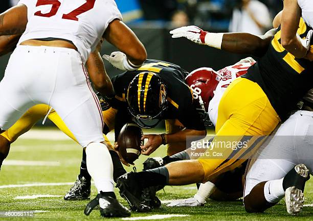 Maty Mauk of the Missouri Tigers recovers his fumble against the Alabama Crimson Tide in the third quarter of the SEC Championship game at the...