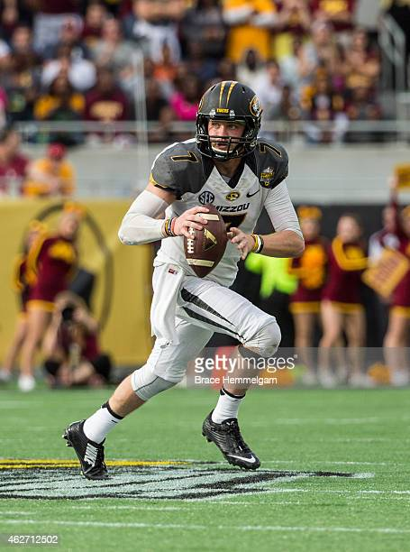 Maty Mauk of the Missouri Tigers runs in the Buffalo Wild Wings Citrus Bowl between the Minnesota Golden Gophers and the Missouri Tigers at the...
