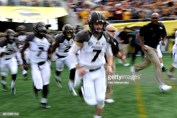 Maty Mauk of the Missouri Tigers runs onto the field after a halftime break during the Buffalo Wild Wings Citrus Bowl against the Minnesota Golden...