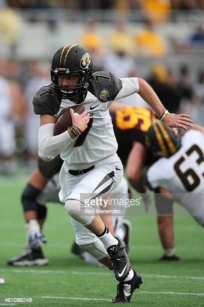 Maty Mauk of the Missouri Tigers runs with the football during the Buffalo Wild Wings Citrus Bowl against the Minnesota Golden Gophers at the Florida...