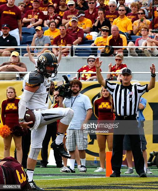 Maty Mauk of the Missouri Tigers rushes for a touchdown during the Buffalo Wild Wings Citrus Bowl against the Minnesota Golden Gophers at the Florida...