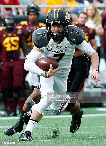Maty Mauk of the Missouri Tigers scrambles for yardage during the Buffalo Wild Wings Citrus Bowl against the Minnesota Golden Gophers at the Florida...