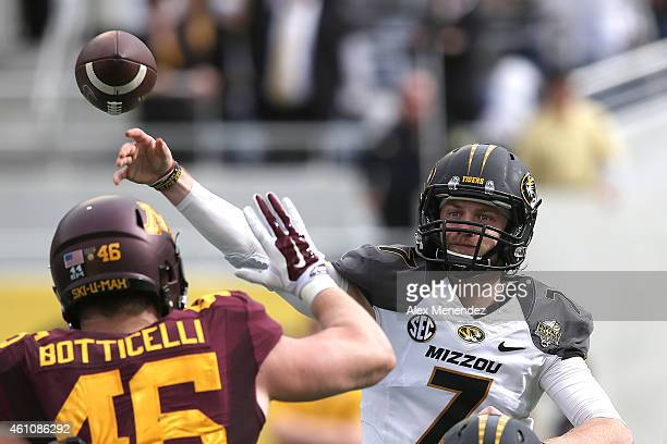Maty Mauk of the Missouri Tigers throws a pass during the Buffalo Wild Wings Citrus Bowl between the Minnesota Golden Gophers and the Missouri Tigers...