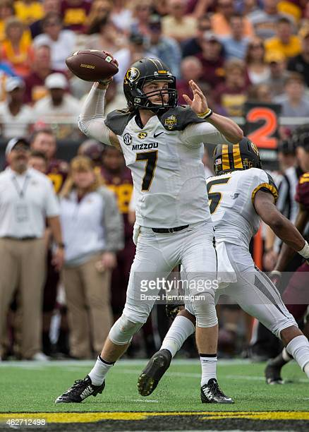 Maty Mauk of the Missouri Tigers throws in the Buffalo Wild Wings Citrus Bowl between the Minnesota Golden Gophers and the Missouri Tigers at the...