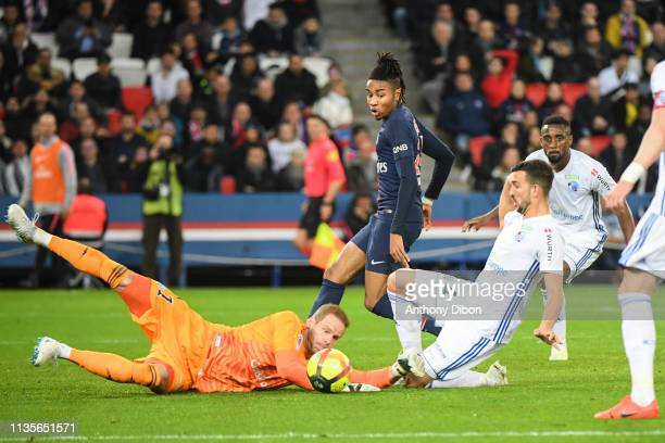 Matz Sels of Strasbourg and Christopher Nkunku of PSG during the Ligue 1 match between Paris Saint Germain and Strasbourg at Parc des Princes on...