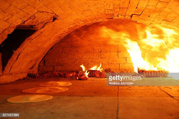 Matza bread baking in a traditional brick oven for Passover, the oven is situated in a small room out the back of Bethune Road synagogue. The baking...