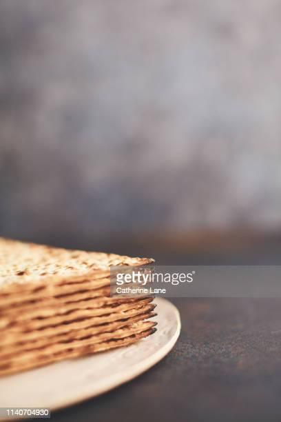 matzo crackers still life - matzah stock pictures, royalty-free photos & images