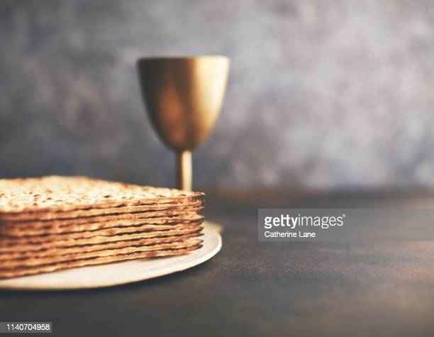 matzo crackers with chalice. still life - happy passover stock pictures, royalty-free photos & images