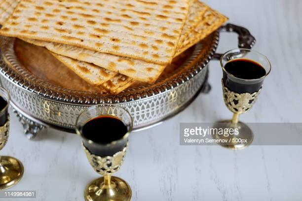 matzo for passover with seder on plate on table close up - passover symbols stock pictures, royalty-free photos & images