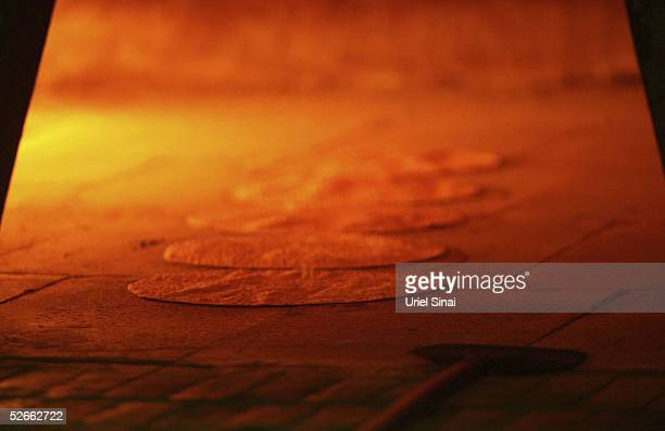 Matzoh a traditional handmade unleavened bread is seen being prepared for Passover in a bakery April 20 2005 in Kfar Habad Israel Jews are forbidden...