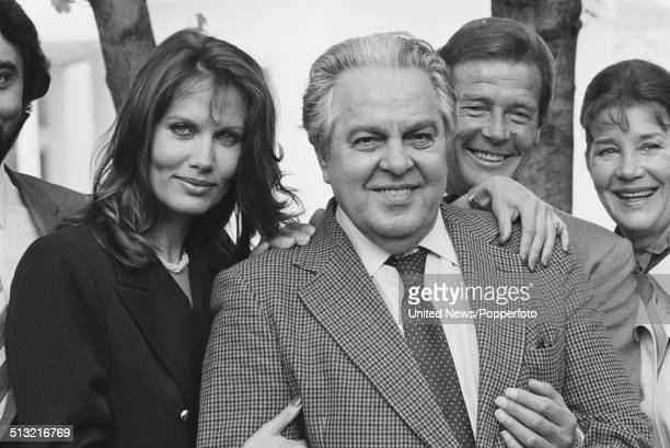 Maud Adams Albert 'Cubby' Broccoli Roger Moore and Lois Maxwell posed together at a press call to promote the James Bond film Octopussy in London on...