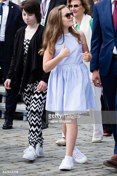 Maud Angelica Behn and Princess Ingrid Alexandra of Norway attend festivities at the Ravnakloa fish market during the Royal Silver Jubilee Tour on...