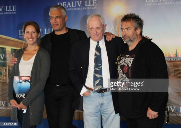 Maud Fontenoy and Louie Psihoyos and Ric O Barry and Luc Besson pose for the screening of the movie 'The Cove at the 35th US film festival in...