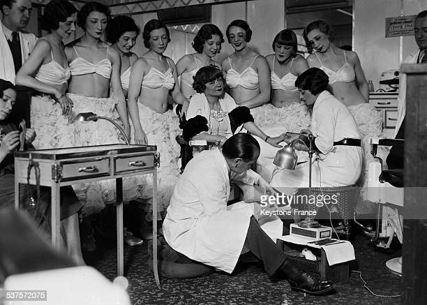 Maud Loty and her chinese chiropodist at the Lido, circa 1930, Paris, France.