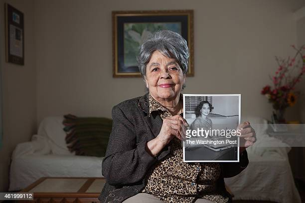 Maude Ballou holds a photo of herself taken when she served as Martin Luther King Jr's secretary from 1955 to 1960 in Montgomery AL