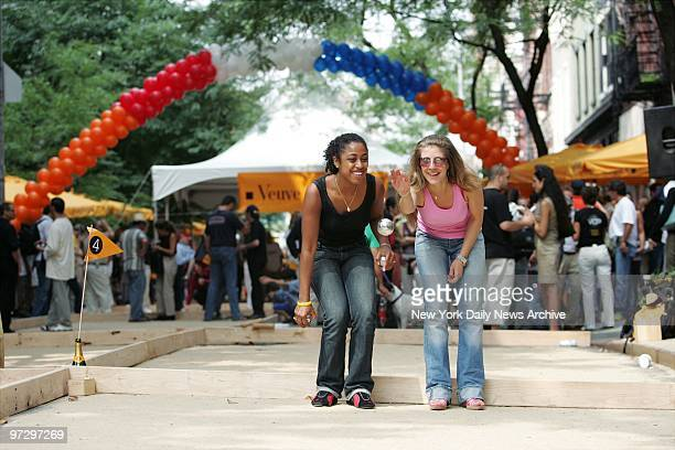 Maude Delice and her mother Christina celebrate Bastille Day at MacDougal and Prince Sts with a game of petanque