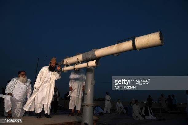 Maulana Abdul Khabeer Azad a member of Pakistan Ramadan moonsighting committee looks through a telescope for the new moon that signals the start of...