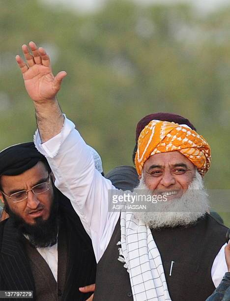 Maulana FazalurRehman Chief of Islamic party JamaiteUlemaiIslam waves to supporters upon his arrival at the Islam Zindabad Conference in Karachi on...