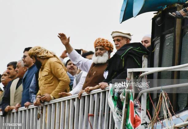 Maulana FazalurRehman of the Islamist political party Jamiat UlemaeIslam waves to a crowd on Nov 1 during a rally in Islamabad Pakistan demanding the...