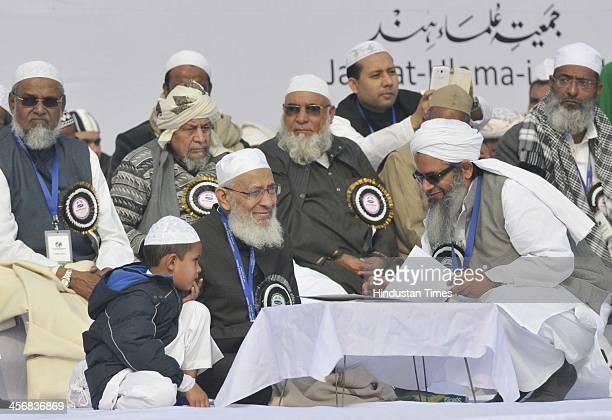 Maulana Mehmood Madani speaking with Hazi Maulana Kari Syed Mahmood Usman Masurpuri as the islamic religious leaders from India and abroad during the...