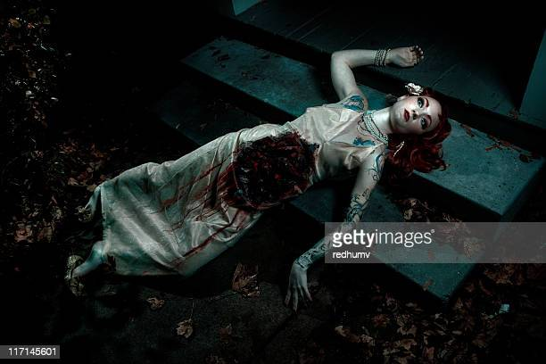 mauled dead woman on steps - gory of dead people stock photos and pictures