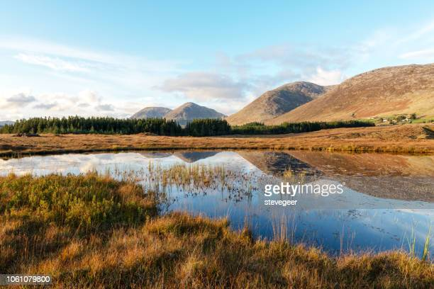 maumturk mountans, lake, autumn, sunset, ireland - republic of ireland stock pictures, royalty-free photos & images