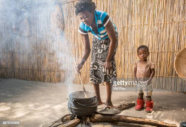 Maun Botswana Sexaxa Village African Woman Cooking Food for the Family
