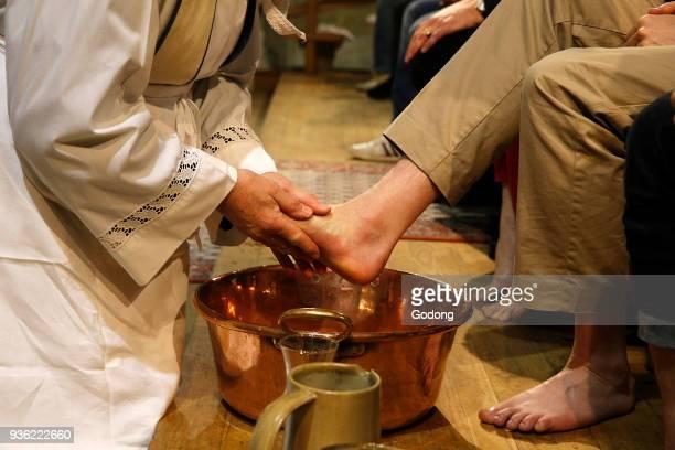 Maundy Thursday celebration in a Parisian catholic church. Priest washing faithfuls' feet.