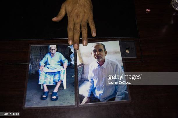 Maung Hla shows photos of his Father and Brother both of which are still living in Sittwe the captial of Myanmar's Rakhine State on February 8 2017...