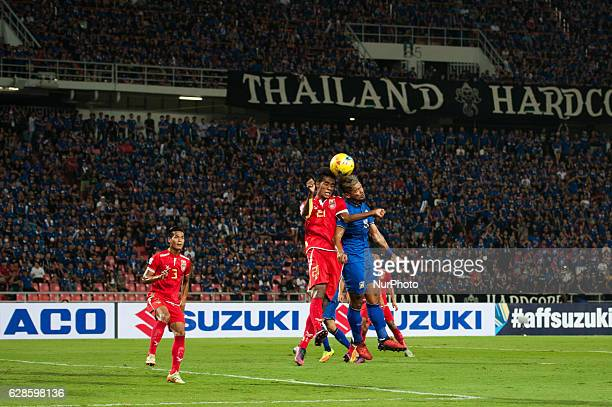 Maung Maung Lwin from Myanmar in action against Pratum Chuthong of Thailand during the match between Thailand and Myanmar AFF Suzuki Cup Semifinals...