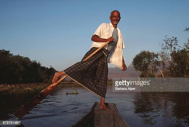 Maung Oo a boatman leg rowing on Inle Lake in Burma February 1988
