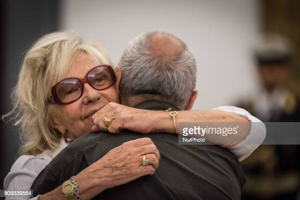 Maura Albites pay their respects to the late Italian actor inside the City Hall in Rome layinginstate inside the City Hall in Rome Wednesday July 5...