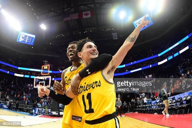J Maura and teammate Jourdan Grant of the UMBC Retrievers celebrate their 7454 victory over the Virginia Cavaliers during the first round of the 2018...