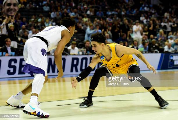 J Maura of the UMBC Retrievers defends Kamau Stokes of the Kansas State Wildcats during the second round of the 2018 NCAA Men's Basketball Tournament...