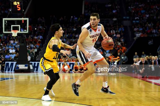 J Maura of the UMBC Retrievers defends Ty Jerome of the Virginia Cavaliers during the first round of the 2018 NCAA Men's Basketball Tournament at...
