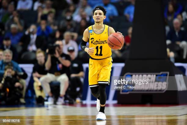 J Maura of the UMBC Retrievers dribbles the ball up the court against the Virginia Cavaliers during the first round of the 2018 NCAA Men's Basketball...