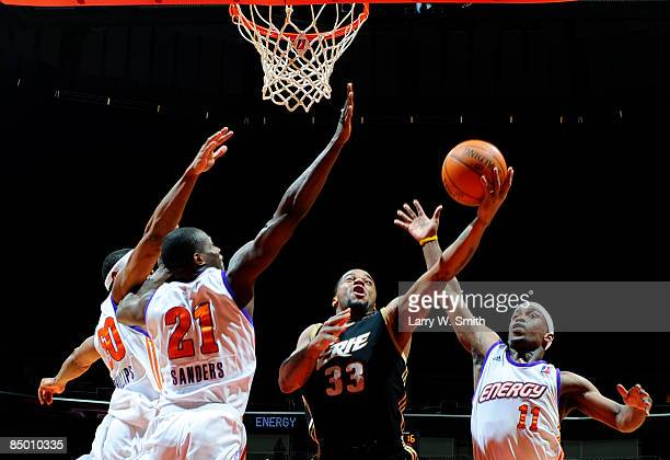 Maureece Rice of the Erie Bayhawks goes for a basket against Marvin Phillips Patrick Sanders Curtis Stinson of the Iowa Energy on February 23 2009 at...