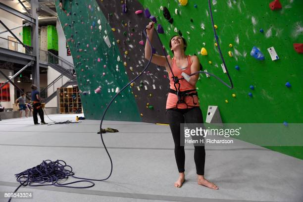 LOUISVILLE CO OCTOBER 25 Maureen Beck belays her climbing partner Sarah Fountain not shown as she climbs on the overhanging wall at EVO Rock Fitness...